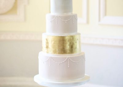 Gold and blush piped pearl wedding cake