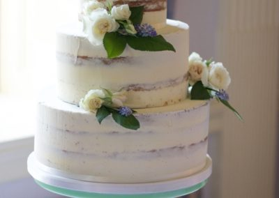 Semi naked cake with garden flowers